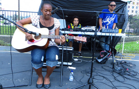 Aaliyah Ashley plays guitar at Black Creek SNAP event