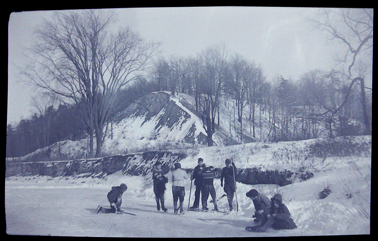archival photo of boys playing hockey at the Forks of the Don