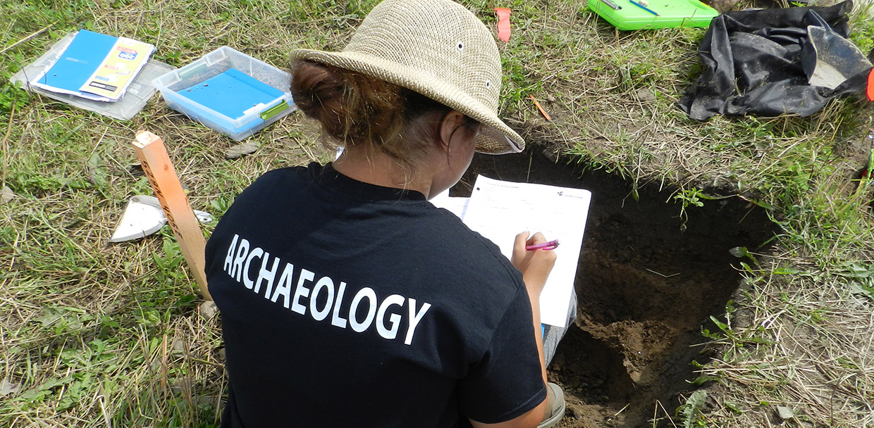 student works on site excavation at Boyd Archaeological Field School
