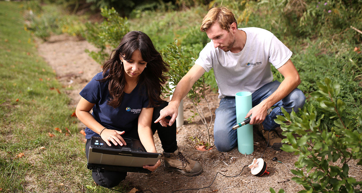 STEP team members collect stormwater data in the field