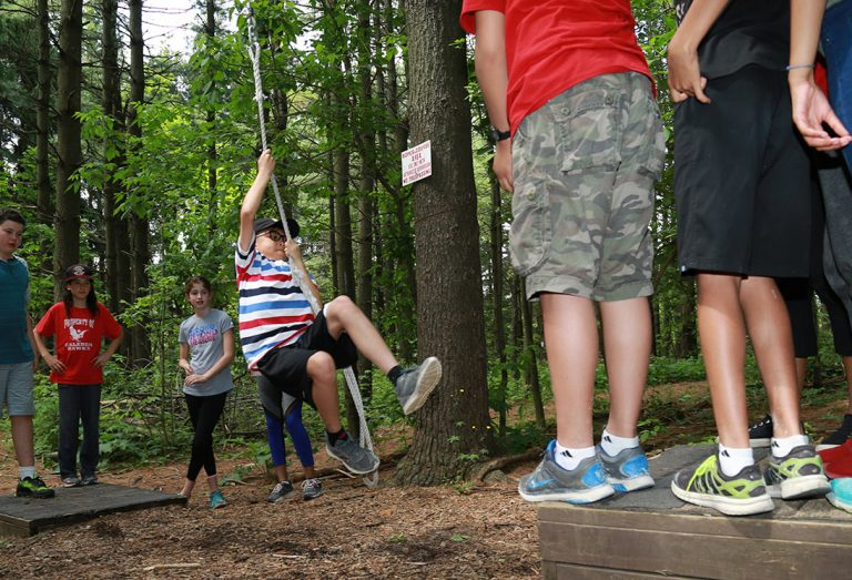 children swing on low ropes at Albion Hills Field Centre summer camp