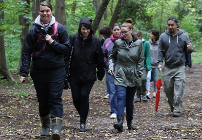 corporate group hikes trail at Albion Hills Field Centre