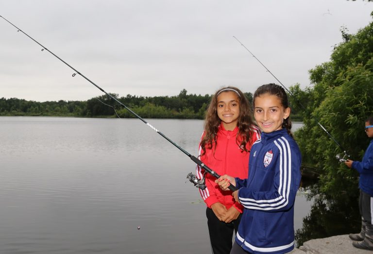young girls fishing at Heart Lake Conservation Area