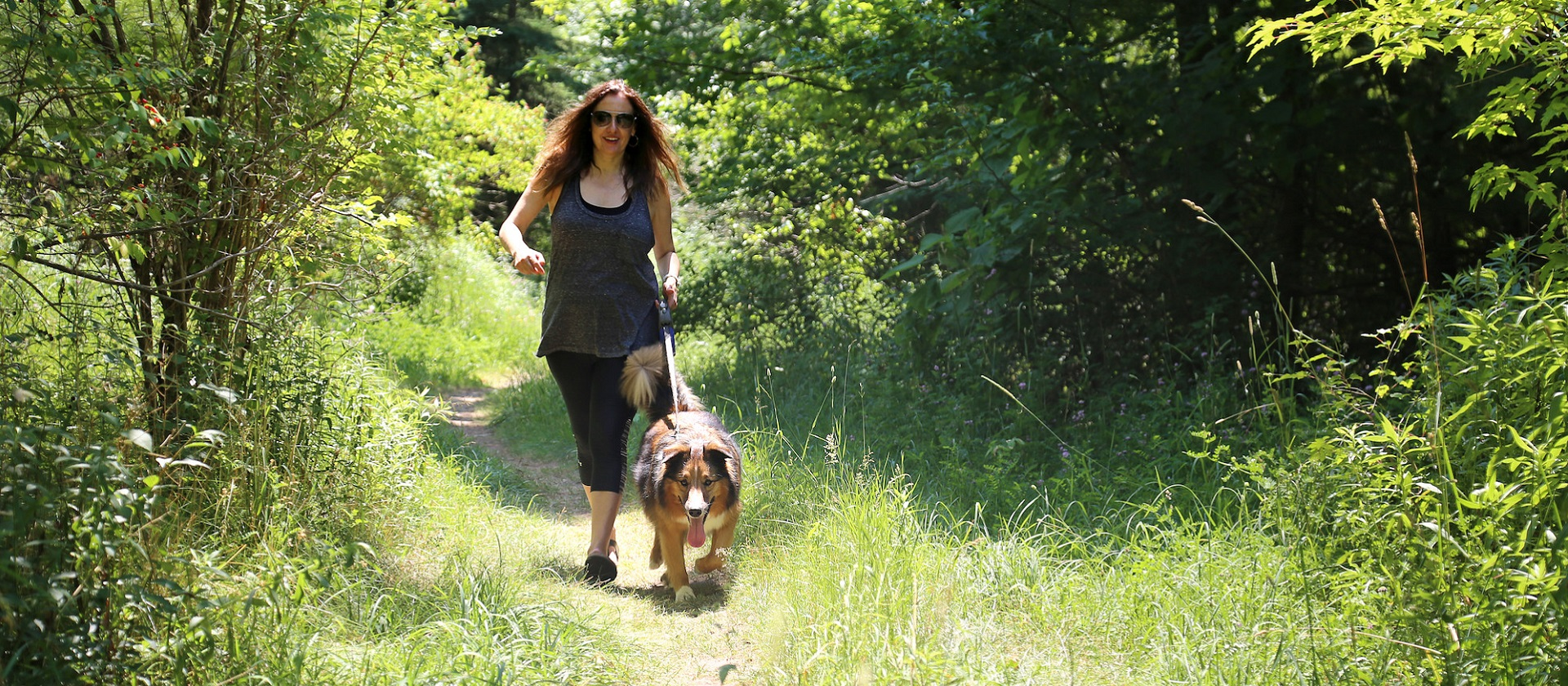 woman walking dog on leash at TRCA park